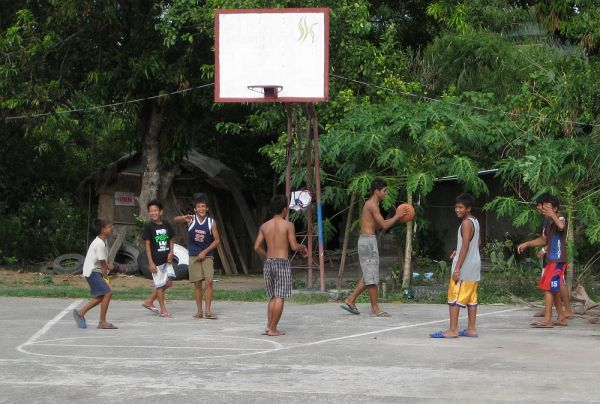 Boys playing basketball in Bagabag